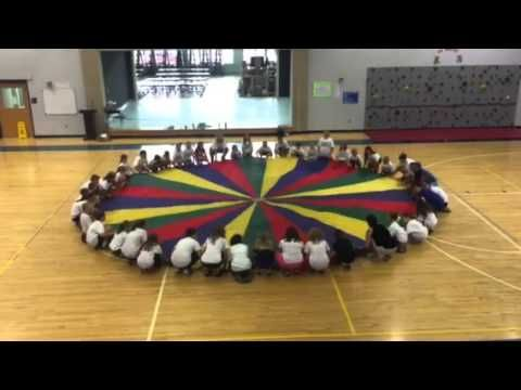 Students at the inquiring minds day camp in Glasgow, Kentucky perform a parachute routine to the theme from Star Wars. Musical expression through motion and ...