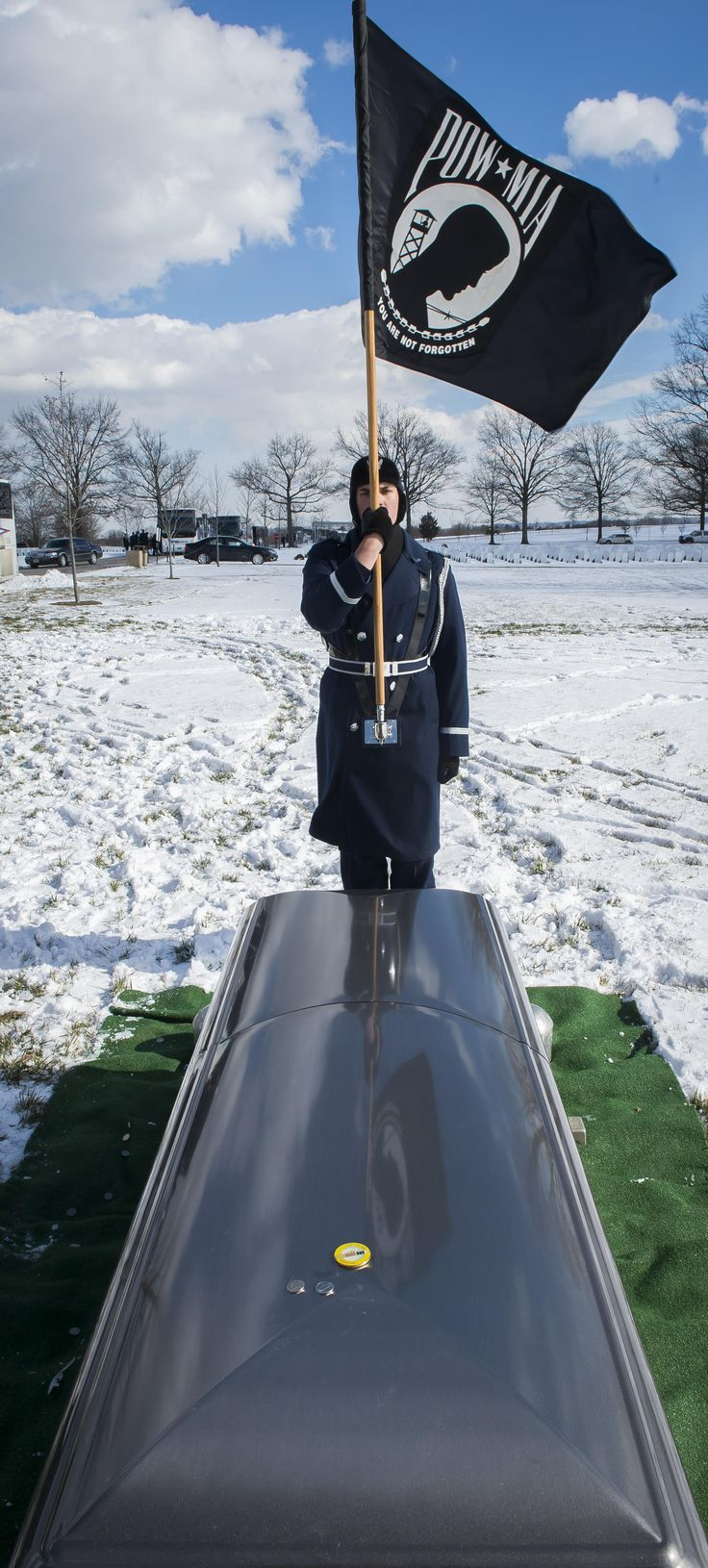 """A member of the U.S. Air Force Honor Guard stands vigil following Brig. Gen. Robinson """"Robbie"""" Risner's full honors military funeral at Arlington National Cemetery, Arlington, Va., Jan. 23, 2014. Risner was the Air Force's 20th Ace and and survived seven and a half years of captivity as a Prisoner of War (POW) in Hoa Lo Prison, a.k.a the Hanoi Hilton. during the Vietnam War. (U.S. Air Force photo/Jim Varhegyi)"""
