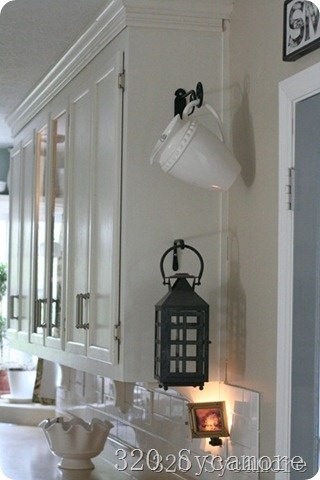 Great idea! Decorative hooks on sides of cabinets to hang some cute decor.