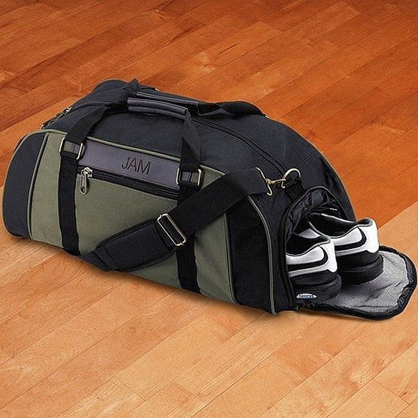 Fabric gym bag with leather trim and personalized with 3 initials or first name is small enough to store in tight spaces and large enough to hold a pair of training shoes, shorts and shirt and personal towel