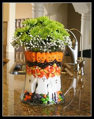 Adorable floral decoration for Halloween table on the cute not spooky side! Candy, marshmallow ghosts and pumpkins, candy corn, so colorful!