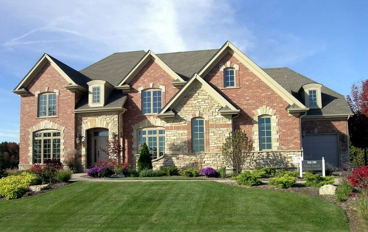 Red brick with light stone accents exterior materials for Stone and brick home designs
