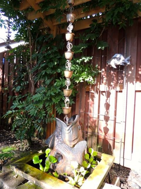 Rain Chains are not limited in only serving as an alternative to gutter downspouts-you can add your own personal touch and use them in a creative way- to function as a water fountain like this homeowner did. #home #garden #fountain #landscapes #rainchains #Hammeredcuprainchain