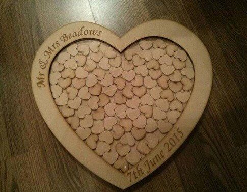 A personal favorite from my Etsy shop https://www.etsy.com/uk/listing/236607455/wedding-drop-box-guestbook-dropbox