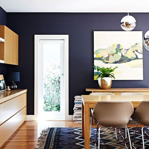 Suzanne Gorman chose a dramatic indigo for her dining room wall