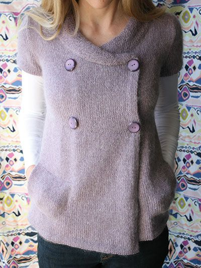 The bodice of this beautiful empire-waist cardigan with pockets is knit in pieces with set-in sleeves, and the skirt portion is picked up from the bottom of the bodice and is worked down to the hem. The sleeves are then worked along with the skirt in...