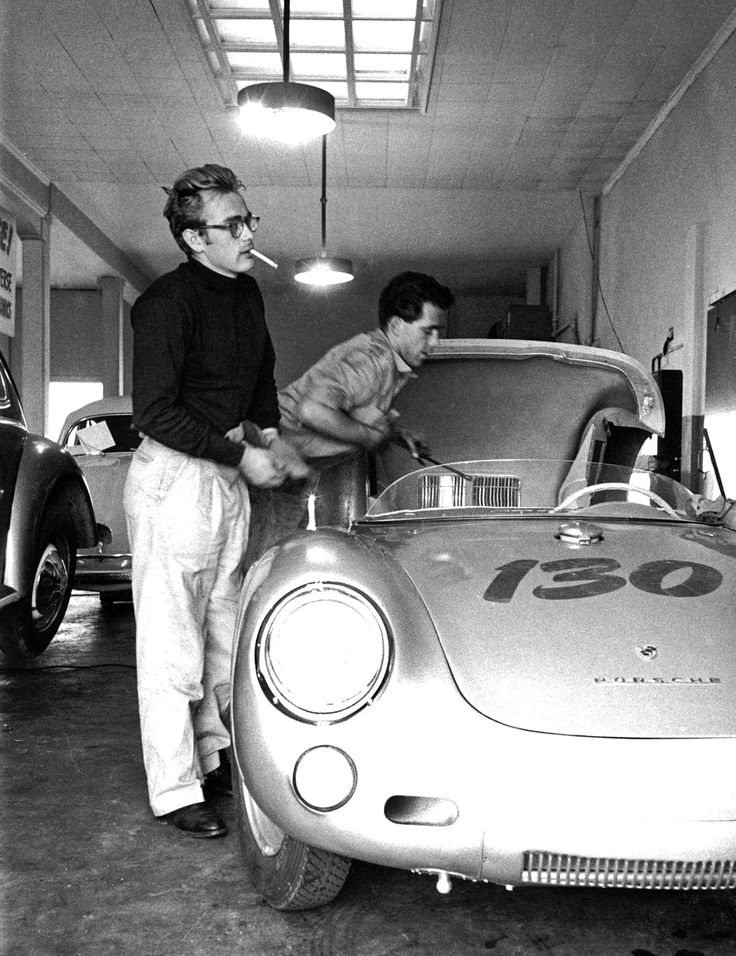 At 'Competition Motors' in Hollywood, Rolf Wütherich preparing James Deans Spyder 550 in presence of James Dean and Bill Hickman (offscreen), just a few days before the company leaves for Salinas where James Dean would participate in a major race. By a dramatic accident he would never arrive. This is one of the last pictures with James Dean, taken by Sanford Roth.