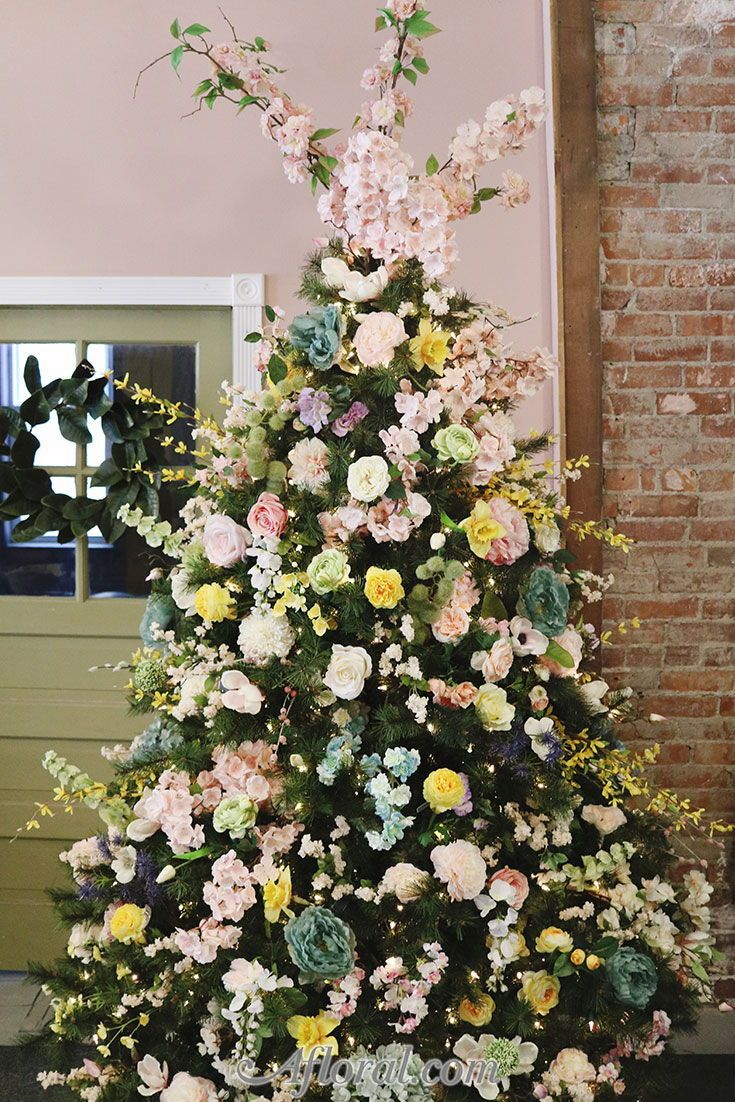 Trending In 2018 Floral Christmas Trees Find Silk Flowers For Your Holi Floral Christmas Tree Christmas Flower Arrangements Floral Christmas Tree Decorations
