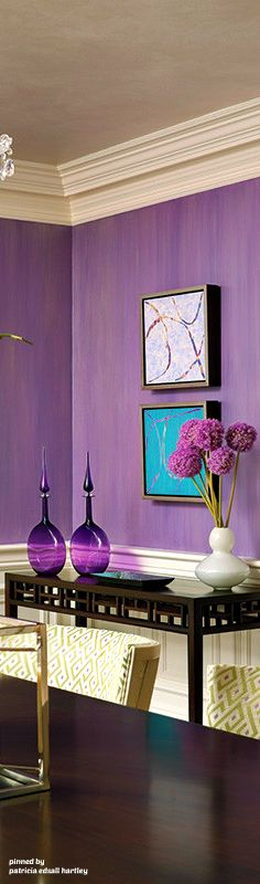 This purple accent wall adds a nice piece of color to the room without being too over whelming. It inspires the eye to scan the room without giving you a headache.
