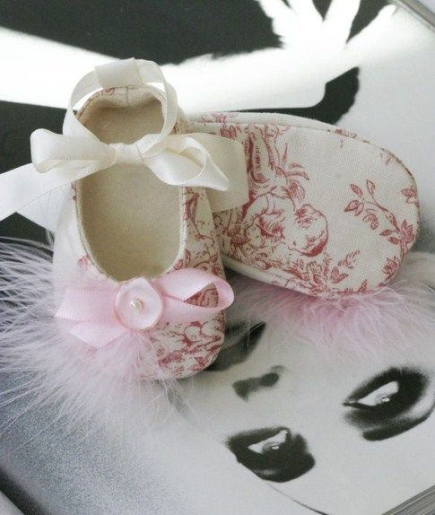 The upper is a charming toile, featuring chubby babies in the woods. The shoes are lined with natural canvas and the insole is soft fleece. Ivory ribbon, woven through the loop at the back makes it easy to convert from a flat to a traditional ballet slipper, because Baby has to keep her fashion options open. Made in true couture style with all seams hidden for extra comfort #timelesstreasure