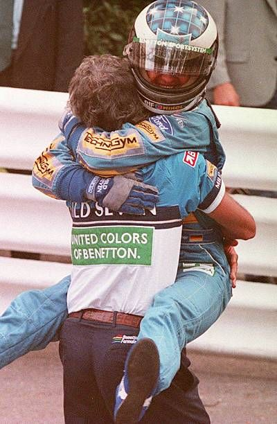 BenettonFord's team manager Flavio Briatore hugs his champion Michael Schumacher after the fourth consecutive win of the German driver in a Grand...