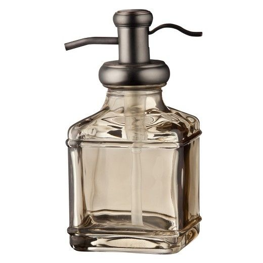 Give your bathroom sink a new look with a Threshold Antique Glass Tall Soap Pump. This soap dispenser pump lets you easily get the right amount of soap to wash your hands with. It has a gorgeous antique appearance with clear tinted glass and bronze hardware. Set this soap pump on your sink with matching bath accessories for a complete look. You could also use it as a lotion dispenser or as your kitchen soap dispenser if you wanted to.