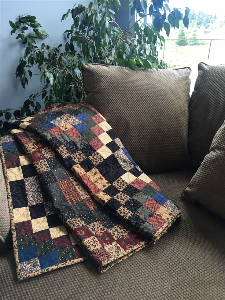 Comfy corner with gorgeous homemade quilt and giant round sofa chair from Costco