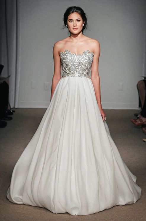For something intricate like Vanessa Lachey's dress, but a little more sleek, this wedding gown by Anna Maier is just the thing.