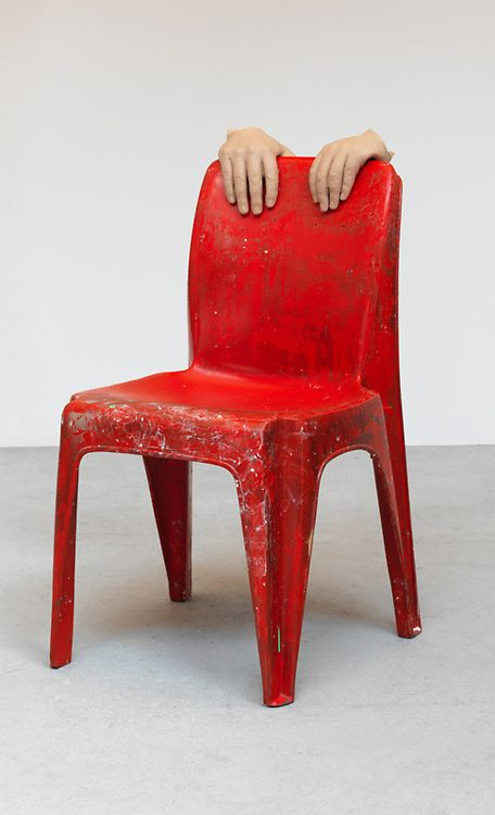 URS FISCHER Fischer edits out the unnecessary and so creates strong, surprising images and sculptures. Here his decision to use only hands on the chair is just enough information to allow the viewer to understand what is going on. This sculpture associates the piece of furniture with the action of pushing in a chair for someone.
