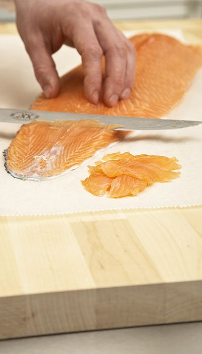 TABLETOP COVERING. Protect your chopping board with SAGA Cooking Paper to prevent bacteria contamination when you work with fish.