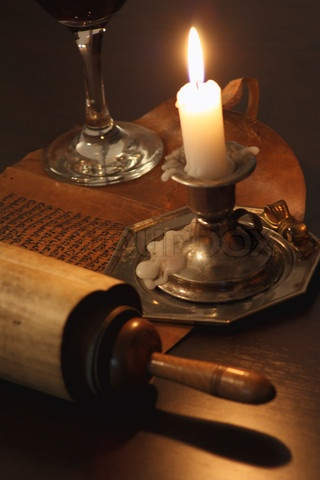 Ancient manuscript in the light of candles'