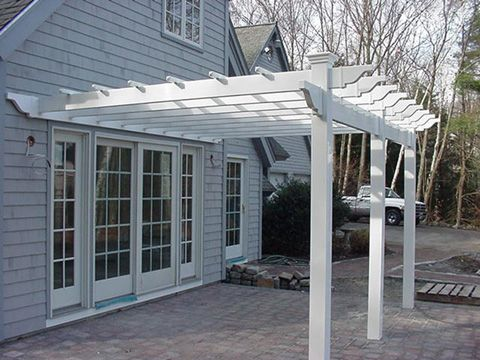 Pergola ideas attached to house attached pergolas add for Attached garage kits