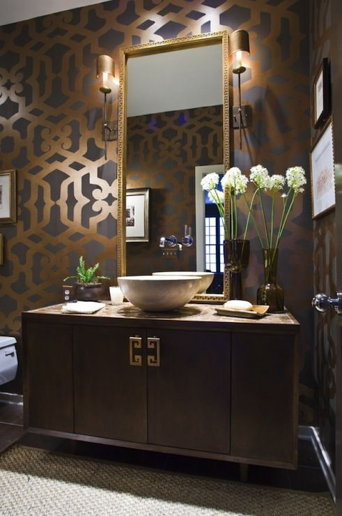 source: Summer House Style Gorgeous bathroom in taupe, brown, gray, and antique gold. Stencil by Virginia Weathersby. Gilt mirror, vintage cabinet bathroom vanity, white porcelain vessel bowl sink, gray taupe gold stencils and Hollywood Regency.