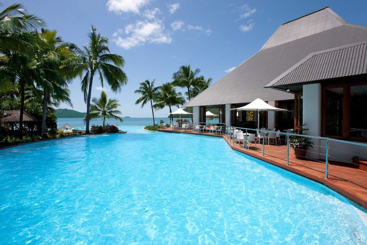 The Main Pool, with its swim-up bar, and the lovely, deep Sails Pool are both right on Catseye Beach. #HamiltonIsland