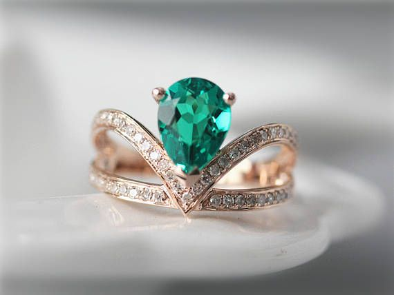 Ring Details:  *Metal Type of this ring is in Solid 14K Rose Gold (Yellow Gold & White Gold are available).  *Main Stone is Pear Cut Lab-Created Emerald  Measurement is around 6x8mm  *Natural Diamonds is Round Cut,Prong,Pave setting  The Carat weight is about 0.26ct  The clarity & color is SI in Clarity and H in color.  *Size: Available for choose  *We offer nice gift box with package for free *Any question, please feel free to contact -------------------------------------------------...