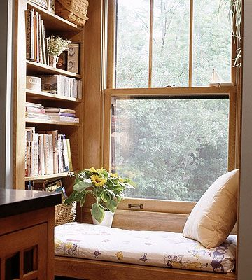 Reading Nook :: What cook wouldn't love this little window seat with an adjoining wall of cookbooks housed on adjustable shelving?