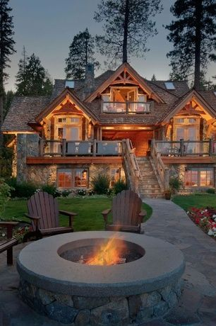 Mediterranean Exterior of Home with Brick and tone paved pathway, Flagstone pathway, Outdoor fire pit, Adirondack chair