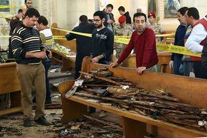 Forensic experts collect evidence at the site of a bomb blast that struck worshippers gathering to celebrate Palm Sunday at the Mar Girgis Coptic church in the Nile Delta City of Tanta, 75 miles north of Cairo.