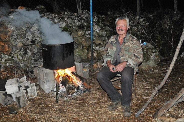 Cooking al fresco in a wood fire in Sfakia.