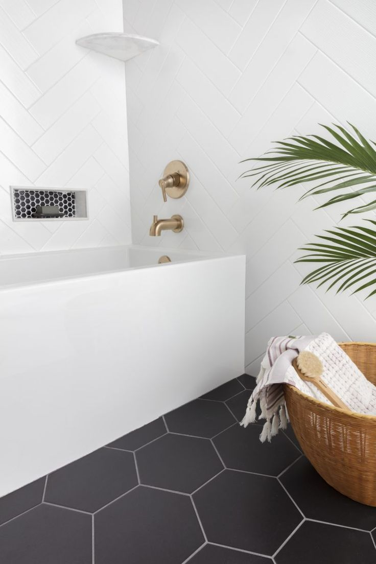 Unique Shapes Are Accentuated In Black And White White Bathroom Tiles Bathroom Tile Designs Stylish Bathroom