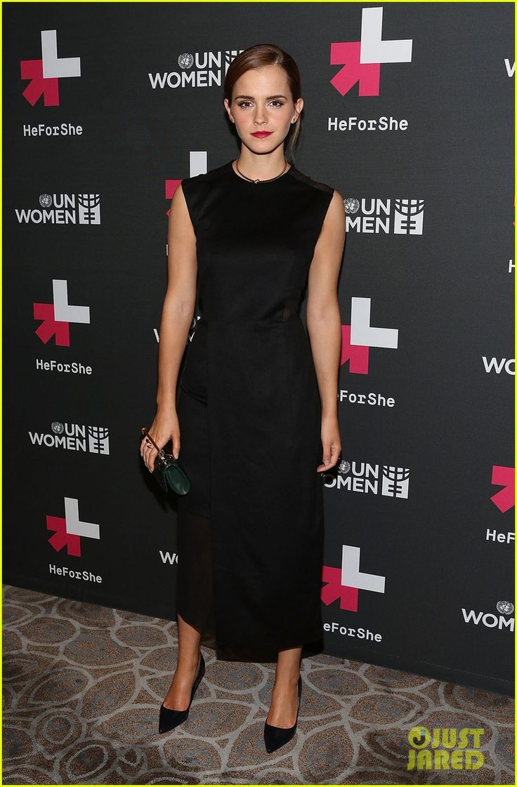 Emma Watson clutches her purse while taking photos at the UN Women's HeForShe VIP After Party held at The Peninsula Hotel on Saturday evening (September 20) in…