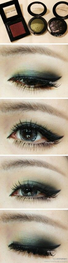 Love the smoky green, individual fake lashes, and winged eyeliner!