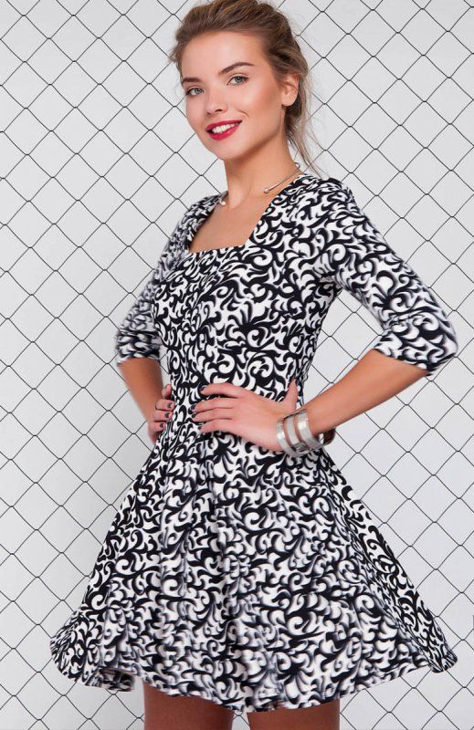 Cover GR1157 sukienka mleczna Elegancka sukienka, wykonana z nowoczesnej tkaniny w modny nadruk, dół pięknie rozkloszowany