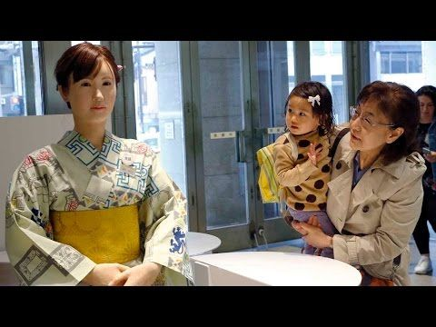 """Meet a Japanese Department Store's New Robot Greeter. Dressed in a kimono and a smile, the lifelike automaton dubbed """"Aiko Chihira"""" began welcoming shoppers to Tokyo's Mitsukoshi department store on Monday. Developed by Toshiba, Chihira is the future of customer service– she is able to guide shoppers around and communicate through both spoken and sign language."""