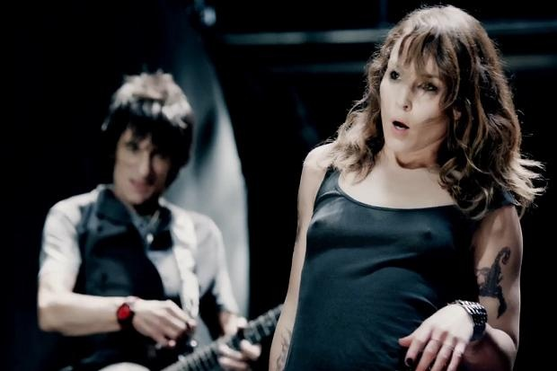 Noomi Rapace bares her boobs for the Rolling Stones