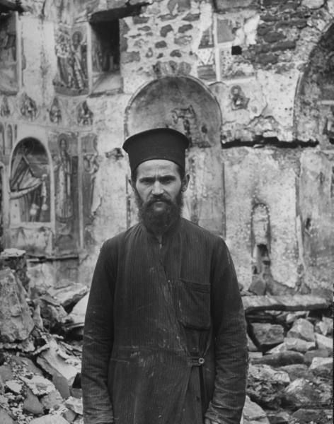 Civil War/Greece  Papageorgion standing in front of one of the seven churches that was destroyed.Location:Louzesti, Greece  Date taken:1947  Photographer:John Phillips