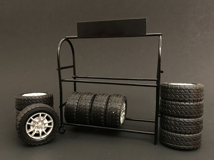 Metal Tire Rack with Tires and Rims For 1:18 Diecast Car Models by American Diorama - Metal Tire Rack For 1:18 Diecast Model Cars by American Diorama. Tires and rims are included. Comes in a color box. Dimensions: L-4.5, W-1 5/8, H-5 3/4 inches.-Weight: 1. Height: 5. Width: 9. Box Weight: 1. Box Width: 9. Box Height: 5. Box Depth: 5