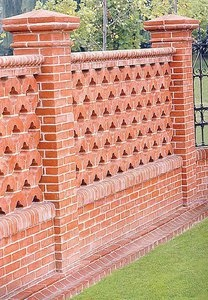 Beautifully detailed brick fence. If you put this up in a city (adjacent to sidewalk?), it would be necessary to seal this to remove graffiti easily, but avoid trapping moisture in the brick. Hmm.