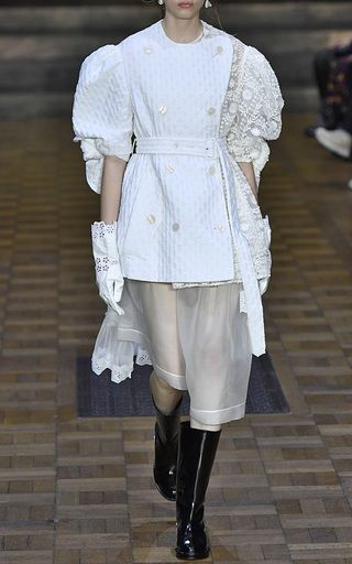 This **Simone Rocha** jacket features double breasted styled buttons, puff sleeves, and a patch fabric construction.