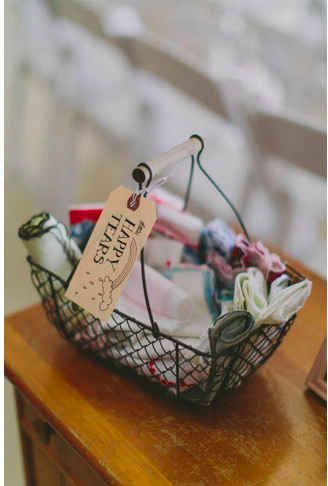 A basket of vintage handkerchiefs is a cute way to provide relief from excessive tears or beads of sweat on an impossibly hot day.