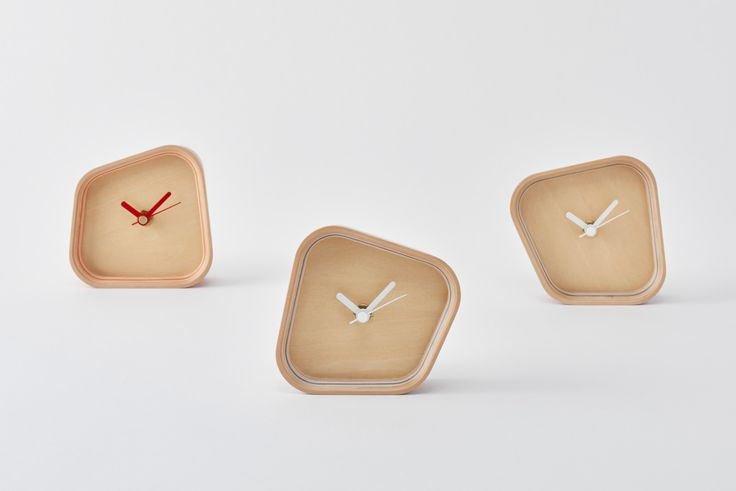 PLYWOOD laboratory | rotation  A clock that can be placed either vertically or horizontally owing to a form born of the hours and angles when the hands overlap. Its sense of presence changes dramatically depending on the way you place it.