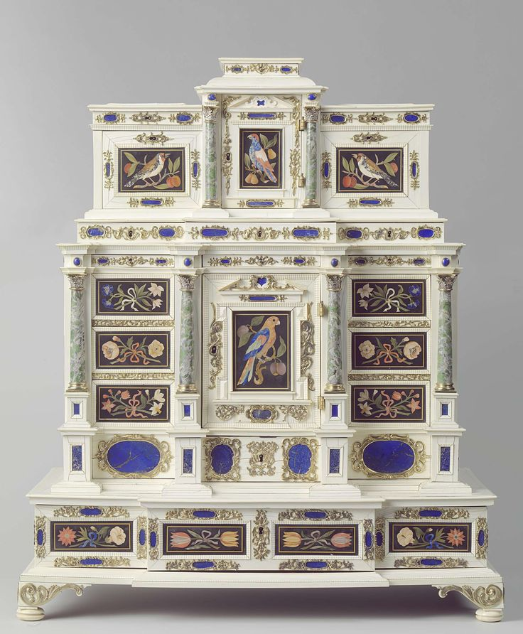 Cabinet. Anonymous: Opificio delle pietre dure, Johann Spitzmacher, c. 1660 - c. 1670. H 81 cm × w 68.5 cm × d 39 cm. The outside of this showpiece combines extremely rare and precious materials. Mosaic panels of various kinds of hardstones (pietre dure) were applied onto a background of ivory, between columns of semi-precious stones. The panels were made in the grand-ducal workshop in Florence. -Rijksmuseum Amsterdam-