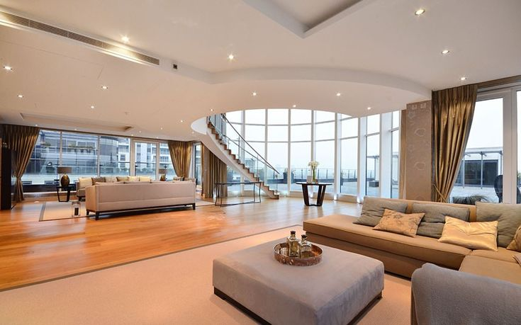 "Not venturing so far away from Fulham Broadway, there are two very incredible linked penthouses in a development known as ""Imperial Wharf"". Arranged over three floors, the penthouses have views over the Thames and London and access to a 24-hour porter, communal gardens and gym. The properties can be bought separately or together to create an enormous family home."