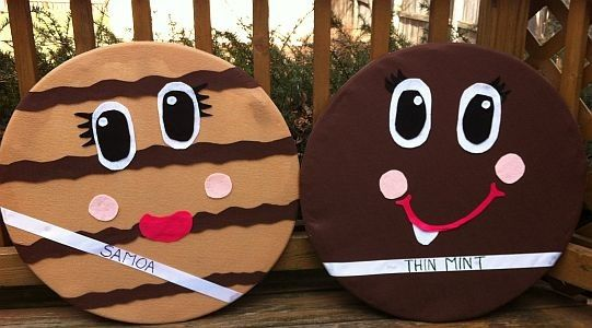 Make these larger-than-life Girl Scout Cookies to promote your Cookie Booth this season! (Hula Hoops, 1 yd each of light brown and brown felt, 2 sheets of white felt, 2 sheets of black, 1 sheet of light pink, 1 sheet of dark pink, puffy paint and ribbon.)