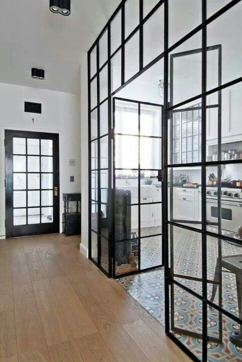 Glass walls. Great way to open a space up. But define areas