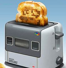HOLY CRAP! I still have my Super FamiCom... I NEED this toaster. (if you don't know what a Super FamiCom is, you are not nerdy enough to be my friend) ;)