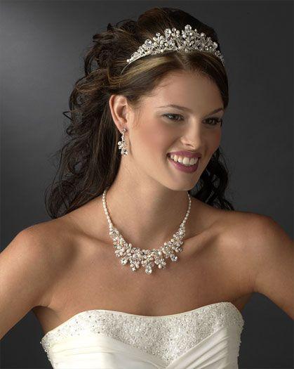 Pretty long wedding hair with tiara.  http://www.weddingfashioning.com/wp-content/uploads/2011/06/08/Pearl-Wedding-Tiaras-2011060846.jpg