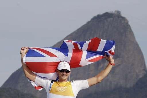 Tearful Argentine cancer survivor wins sailing gold at 54:  August 16, 2016  -     Britain's Giles Scott celebrates winning the men's Finn sailing race at the 2016 Summer Olympics in Rio de Janeiro, Brazil, Tuesday, Aug. 16, 2016. (AP Photo/Gregorio Borgia)