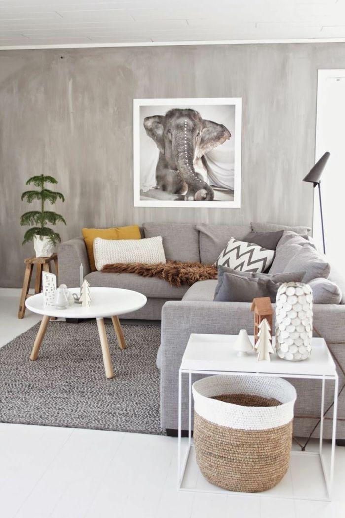 muebles de salon, salón en gris con sofá en forma de L, cuadro con elefante, mesa de café redonda blanca, planta verde