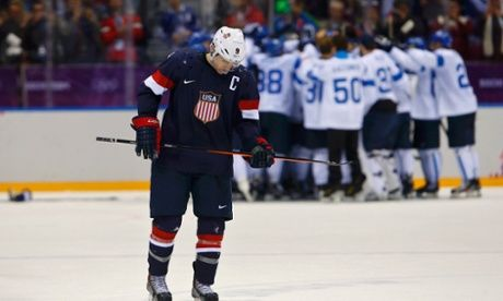 Team USA's Zach Parise skates away as Finland celebrates their win in their men's ice hockey bronze medal game. Photograph: Brian Snyder/Reuters